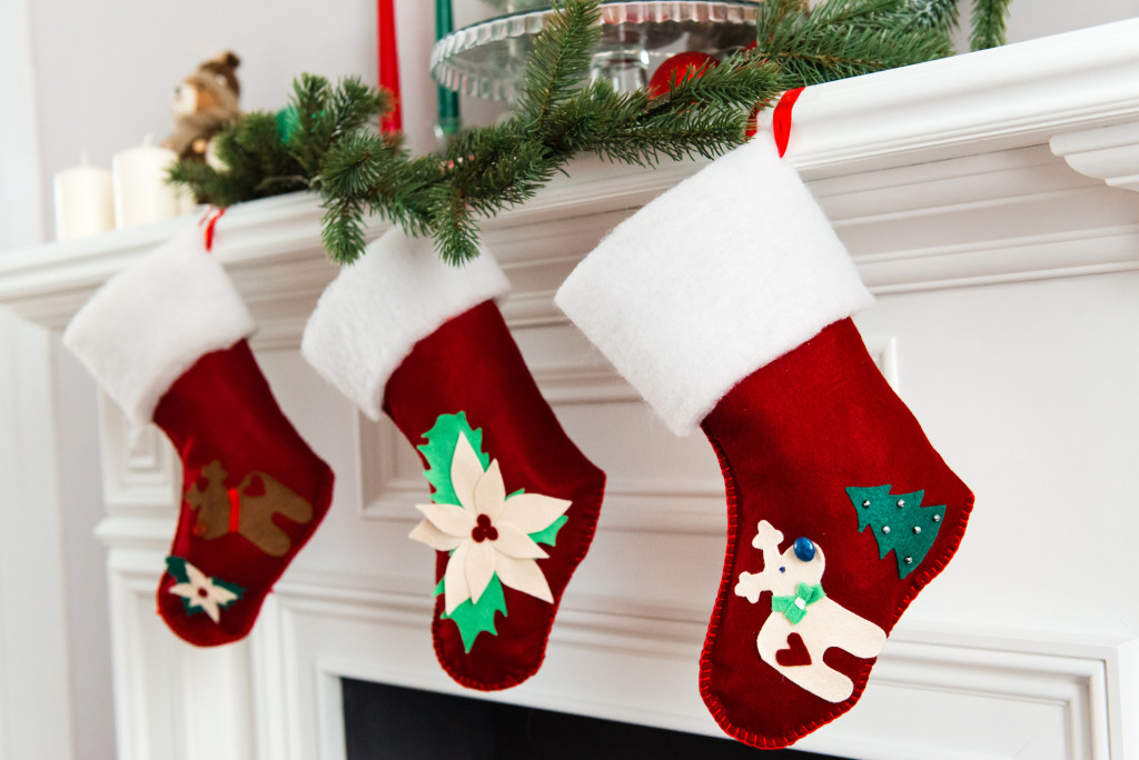 decorated bright red Christmas socks hanging
