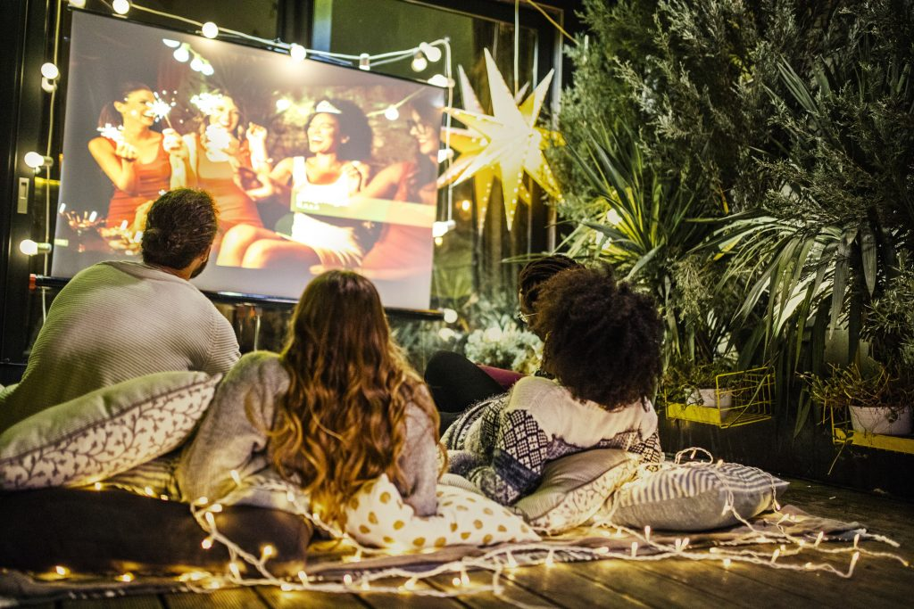 Friends making movie night at back yard